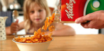 e A child eating Kelloggs c