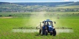 tractor crop spray farm fields herbicides