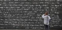 child at math blackboard
