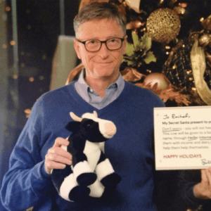 Bill Gates with stuffed cow e