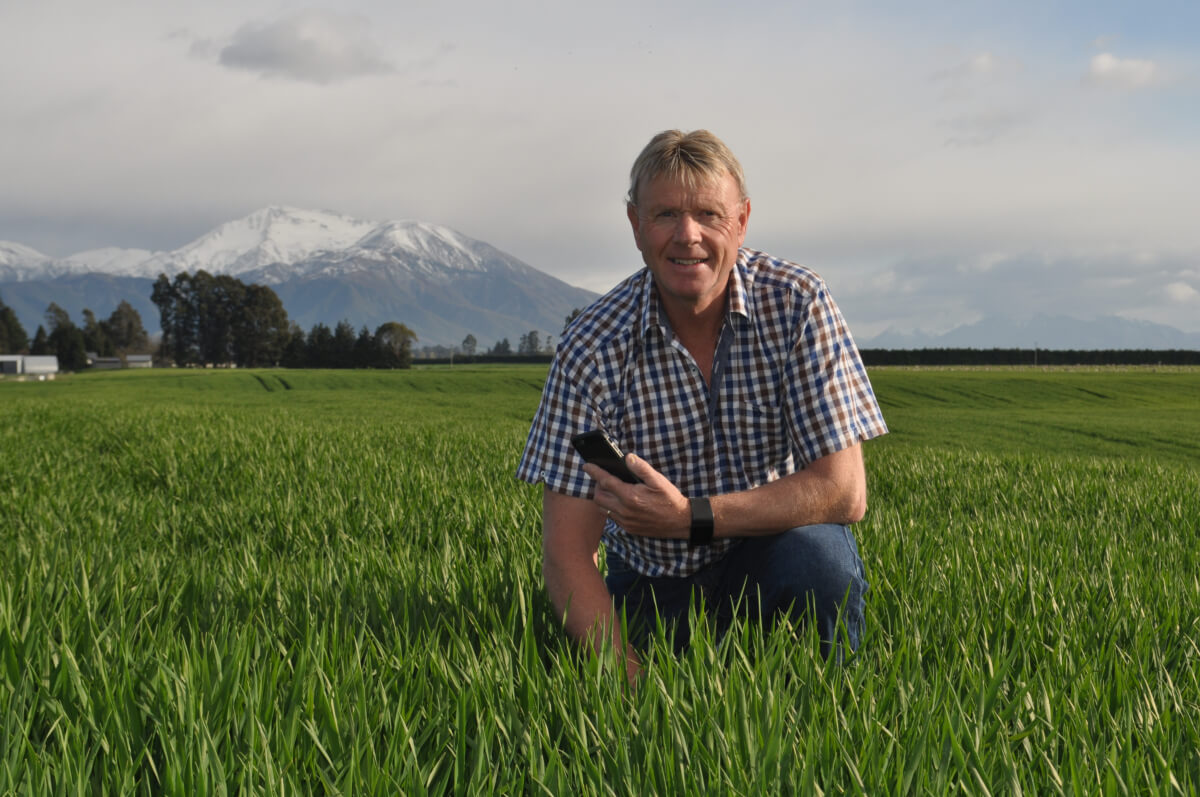 x Mackenzie kneeling in field
