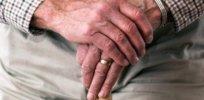 hands walking stick elderly old person