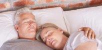 senior man sleeping with wife hero