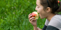 teen girl eating apple csz v