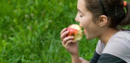 teen girl eating apple csz v