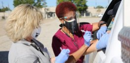 How might mass COVID vaccinations work? Louisiana sets up drive-through flu vaccine effort as a test