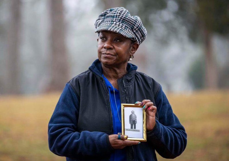 Peggy Fitzpatrick, 65, holds an image of her great grandfather Willie Fitzpatrick, a victim of the Tuskegee Experiments. Despite this, Peggy will still get the COVID vaccine. Credit: Alyssa Pointer