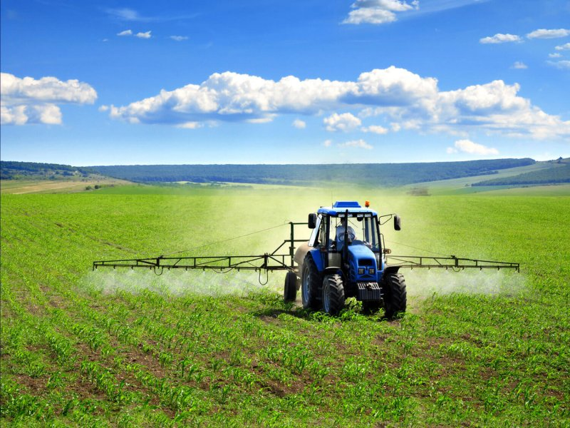 blue tractor sprayer