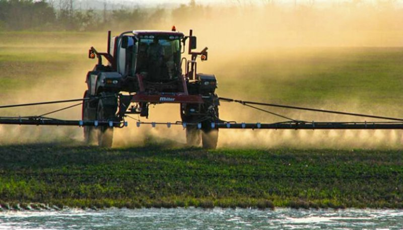 farmer spraying crops can be used for dicamba articles