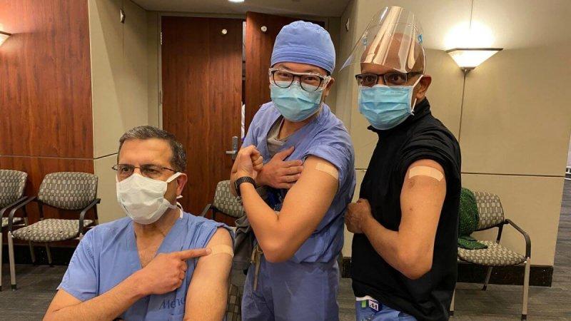 Drs. Faisal Masud, Steven Hsu, and Dharamvir Jain pose after receiving vaccinations at Houston Methodist Hospital. Credit: Greg Abbott