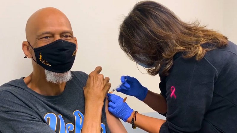 NBA legend Kareem Abdul-Jabbar gets the COVID vaccine. Credit: AP