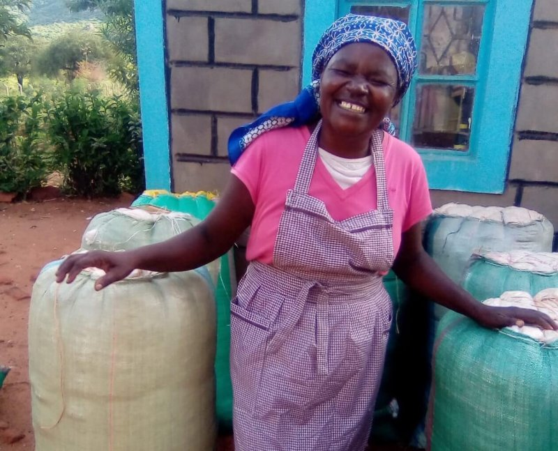 Winifred Kasambu and her Bt cotton harvests Credit: Cornell Alliance for Science