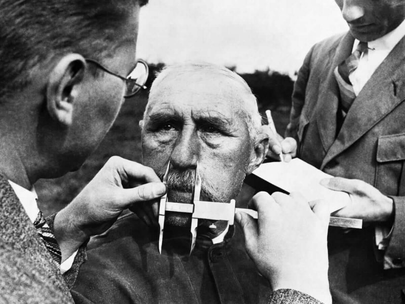 Nazi officials use calipers to measure an ethnic German's nose on January 1, 1941. The Nazis developed a pseudoscientific system of facial measurement that was supposedly a way of determining racial descent. Credit: Hulton-Deutsch Collection/CORBIS/Getty Images