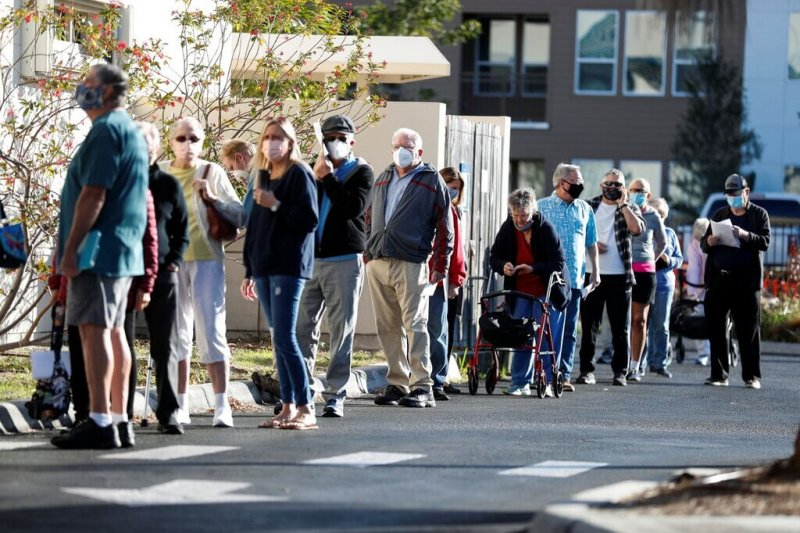 People waiting in line at a vaccination clinic in Sarasota, Fla. Credit: Octavio Jones/Reuters