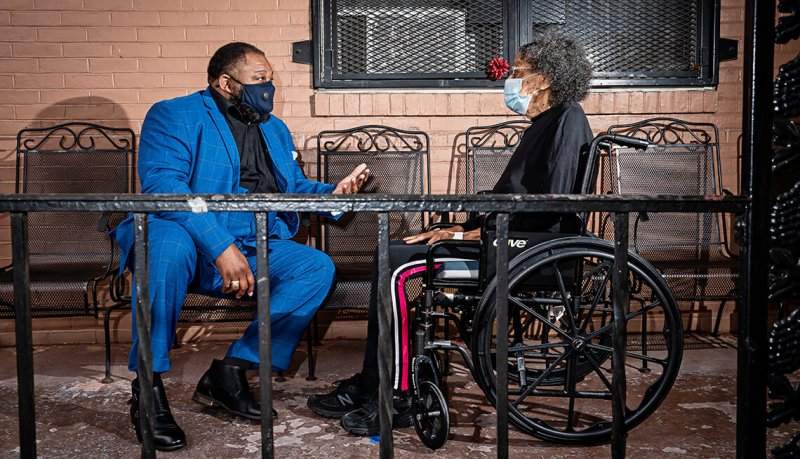 Rev Doc Derrick DeWitt at the Maryland Baptist Aged Home with his aunt, Gerri Alston. Thanks to his efforts, the home has had zero COVID cases or deaths among staff and residents. Credit: Scott Suchman