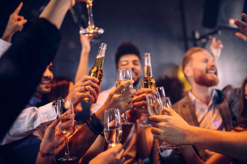 people are drinking alcohol at a party but it could lead to liver cancer