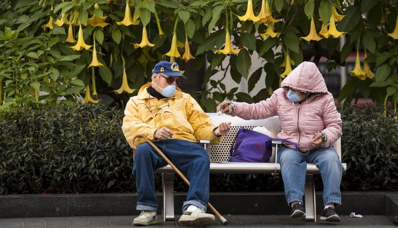 people on park bench imgcache rev ec f ed d bea cce e b