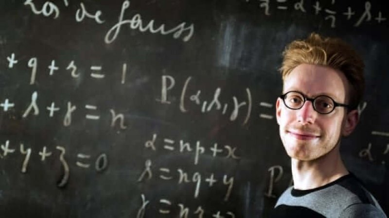 British autistic writer Daniel Tammet poses at a science museum in Paris, as part of the first Pi Day in France. Tammet holds the European record for reciting pi from memory to 22,514 digits. Credit: Lionel Bonaventure/AFP/Getty Images