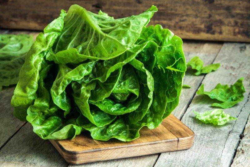 romaine lettuce on wooden chopping board