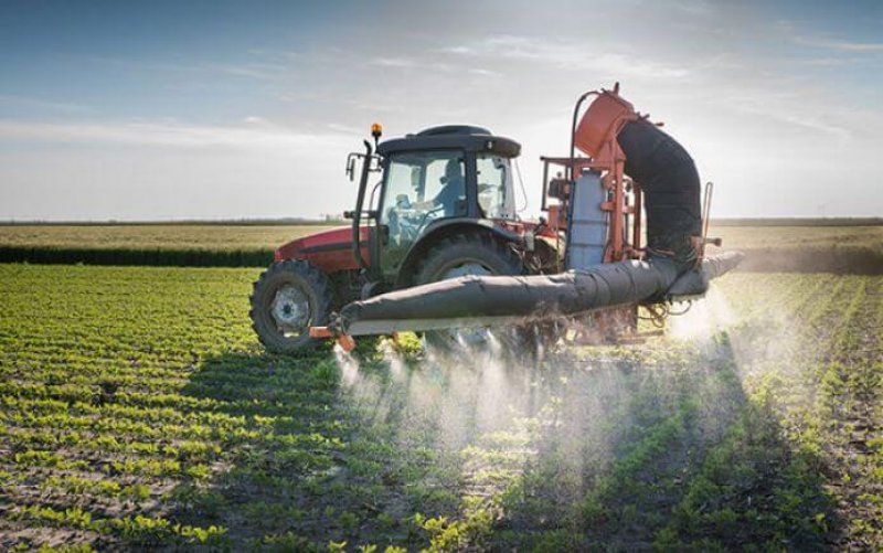 tractor spraying pesticides iowa