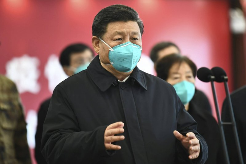 Chinese President Xi Jinping talks by video with patients and medical workers at the Huoshenshan Hospital in Wuhan in central China's Hubei Province. Credit: Xie Huanchi/Xinhua/AP