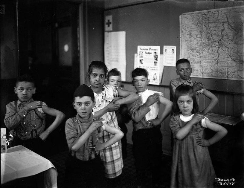School children in Tacoma showing off their new vaccinations, likely for smallpox or diphtheria, in 1922. Credit: Washington State Historical Society