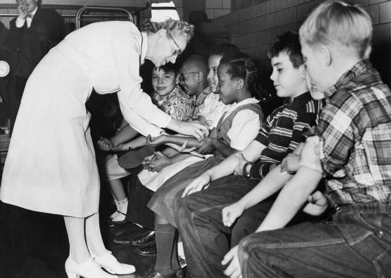 A nurse prepared children for a polio vaccination in Pittsburgh in 1954. Credit: Bettmann/Getty Images